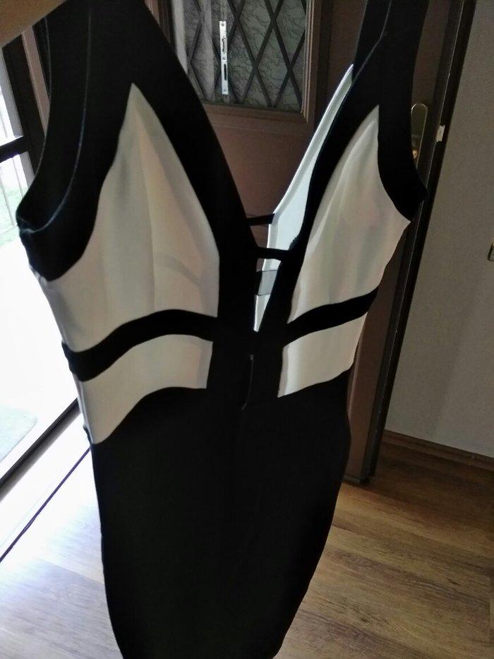 Φόρεμα γυναικείο  μαύρο small midi. Photo 0