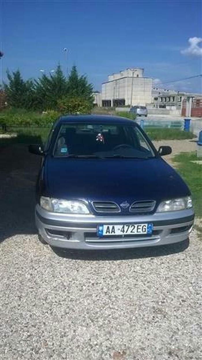 Nissan Primera 1998. Photo 0