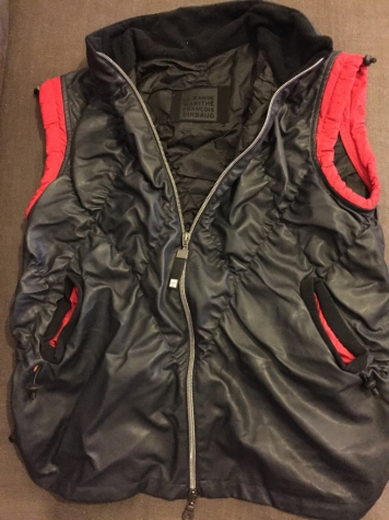 Women's sleeveless black synthetic jacket with red details