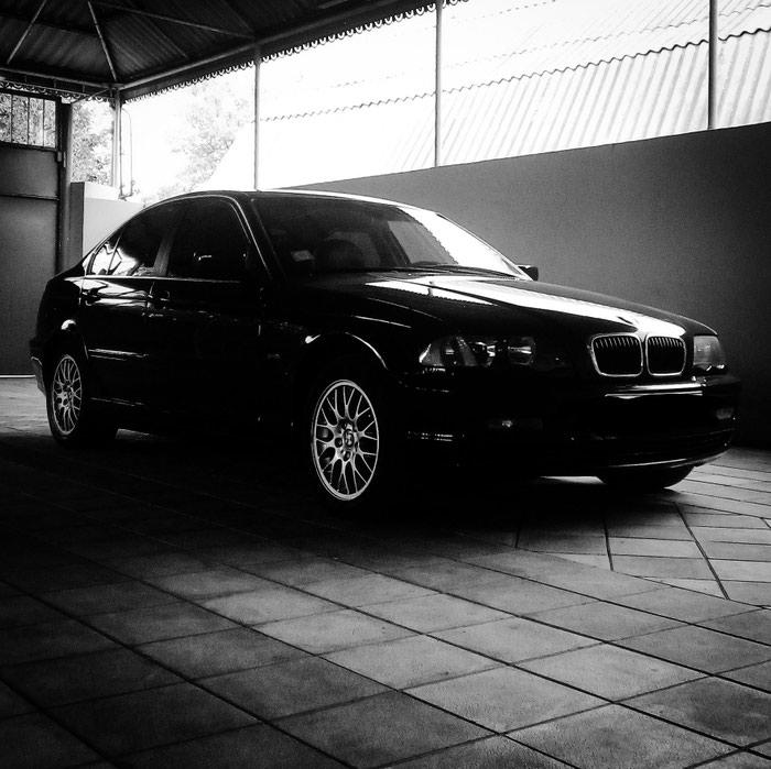 BMW 323 1998. Photo 1