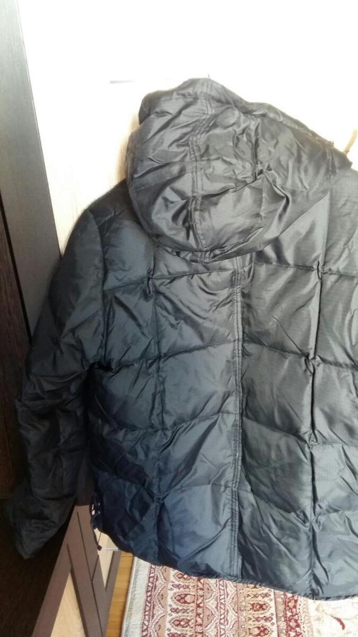 Черная зимняя женская куртка. Photo 2