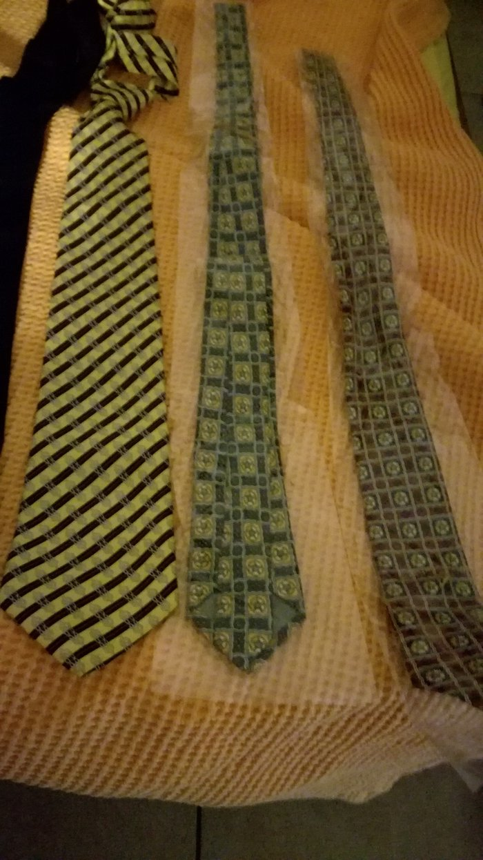 Yellow tie with dark blue stripes (left one)