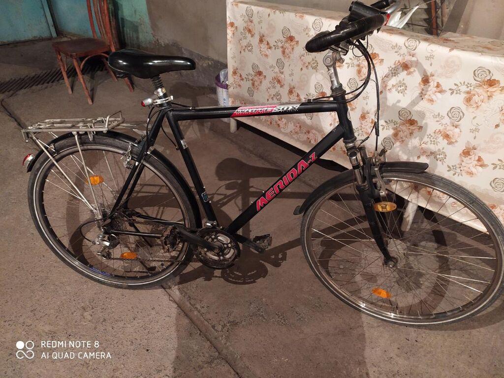 Велосипед Мерида,из Германии,в хорошем состоянии,алюминивая рама,подножка,фонарик передний-задний,богажник,сигнал,крылья,сиденье с амортизатором,хорошая резина,отличный велик для города,держит большой вес,большая ростовка 1