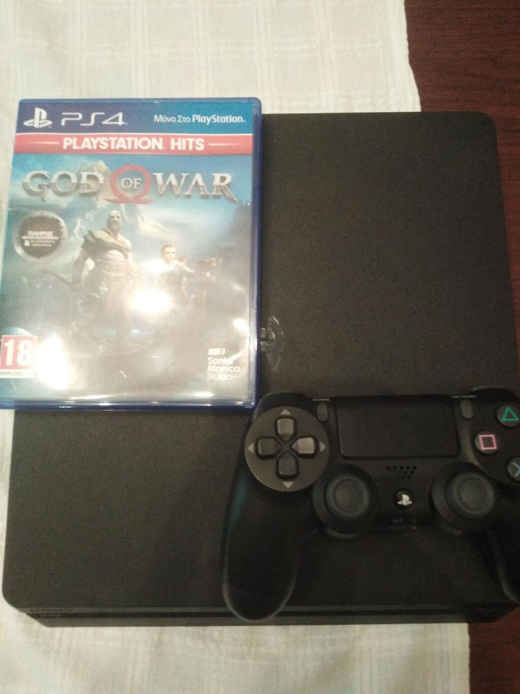 Ps4+controller  me Doro game:to neo God of war