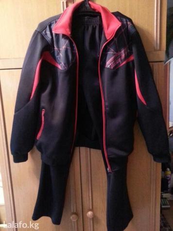 Новый спортивный костюм с капюшоном разм. 48. Photo 0