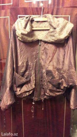 Gəncə şəhərində Qadin ucun kurtqa 46-48 razmerdi  maskvadan  alinib cox  az geyinilib