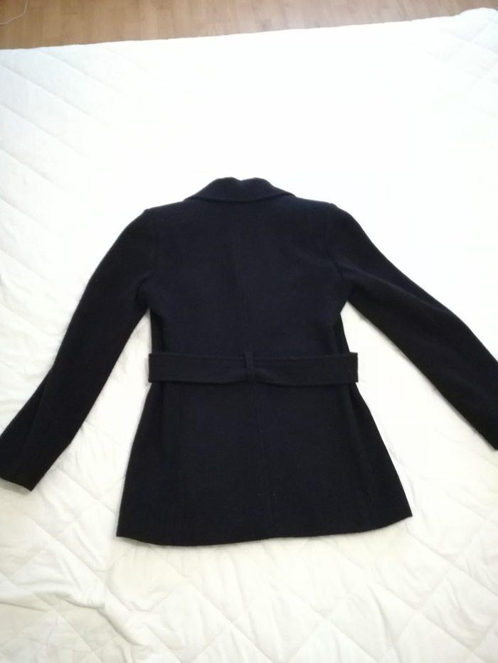 Ženski kaputi. Photo 0