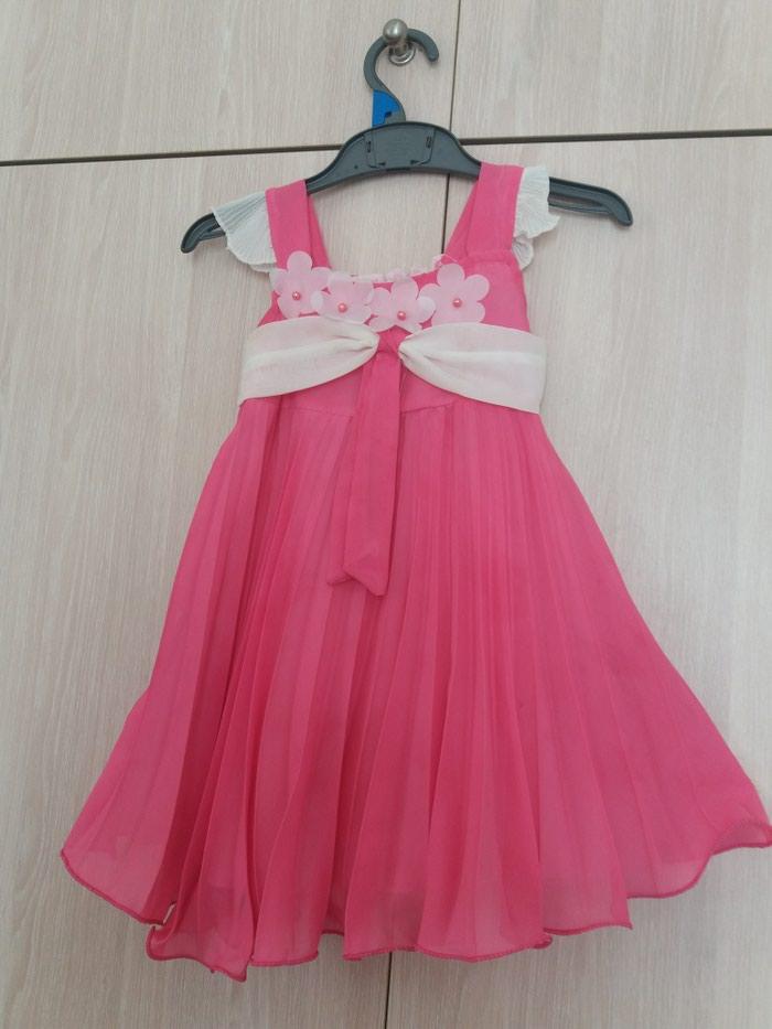 Επισημο φορεμα 2 ετων, με φοδρα, φουξια πλισε. εντελως αχρησιμοποιητο.. Photo 0