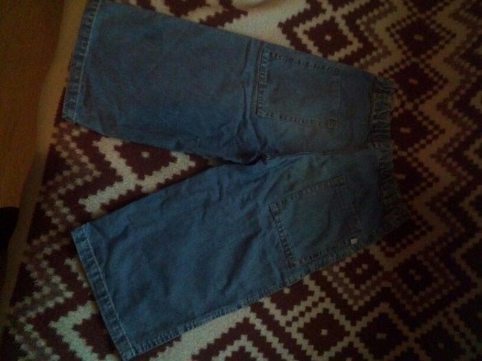 Ocuvane teksas pantalonice tri-cetvrt. Photo 1