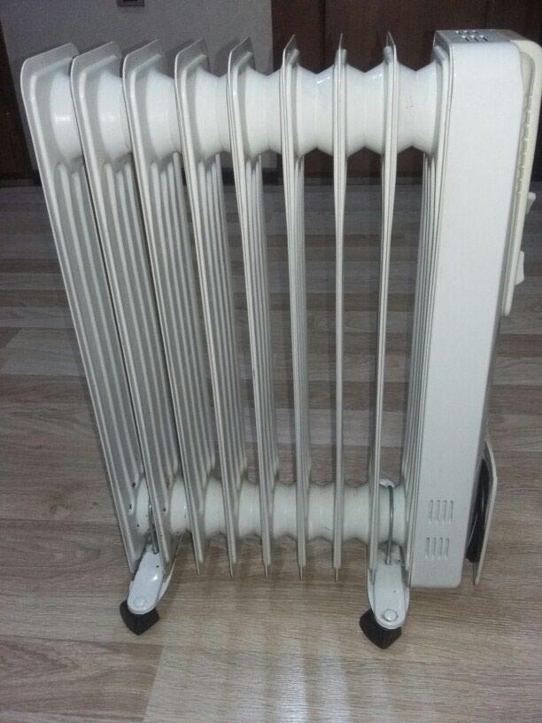 NIKAI.Yağla işləyən elektrik radiatoru 8 sektiyalı super vəziyət. Photo 0