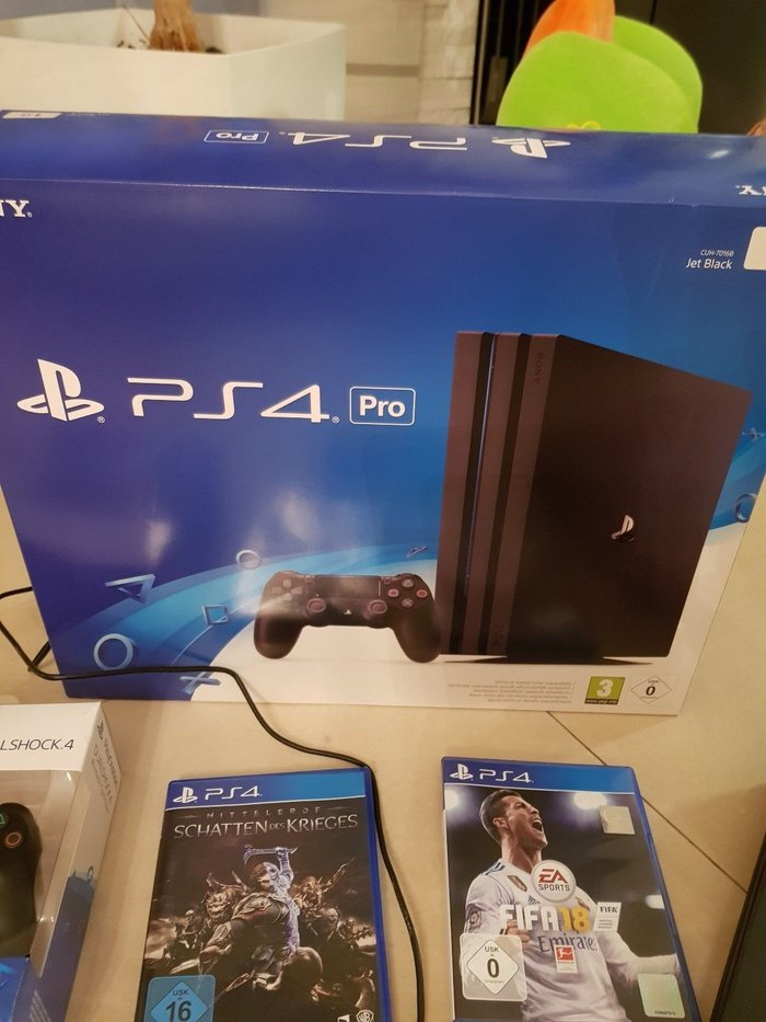 Sony PlayStation 4 Pro 1TB Black Console With 2018 FIFA And 2 Extra. Photo 1