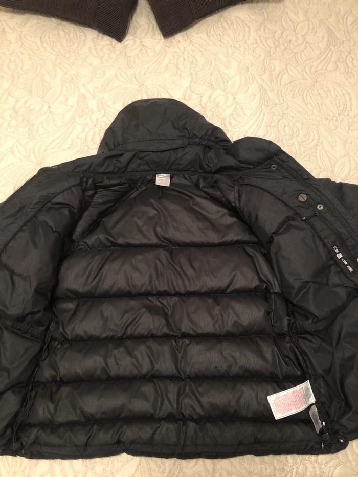 NIKE zenska jakna. Crna,perjana,ocuvana,velicina L.. Photo 2