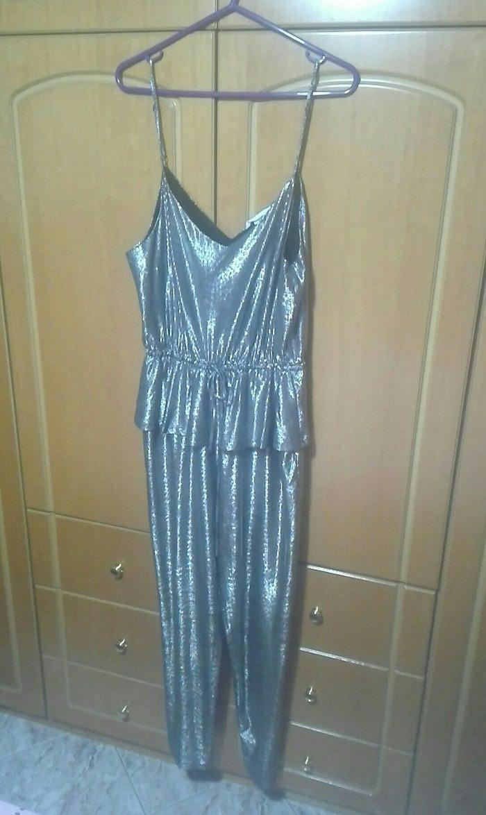 Φόρμα ολόσωμη ασημί large. Photo 0
