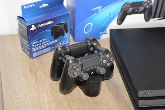 Playstation 4 Pro 1TB, With 2 Controllers and 4 Game Discs. Photo 1