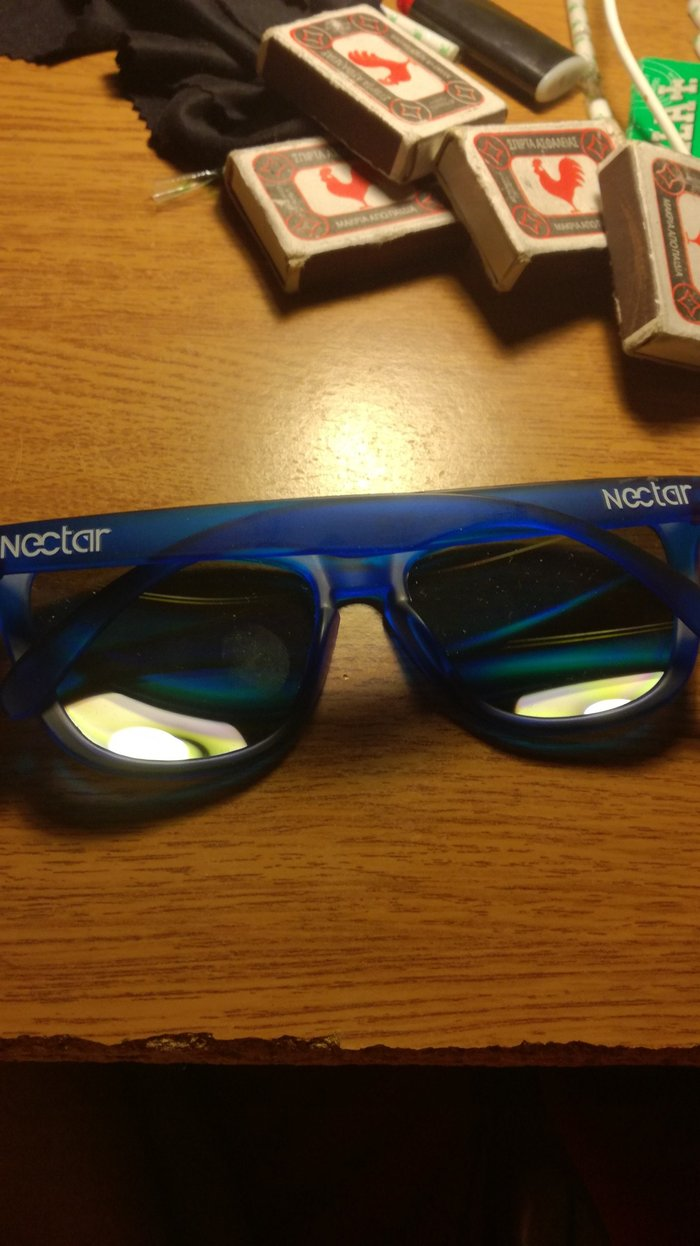 Blue sunglasses with golden lens. Case Included.. Photo 0