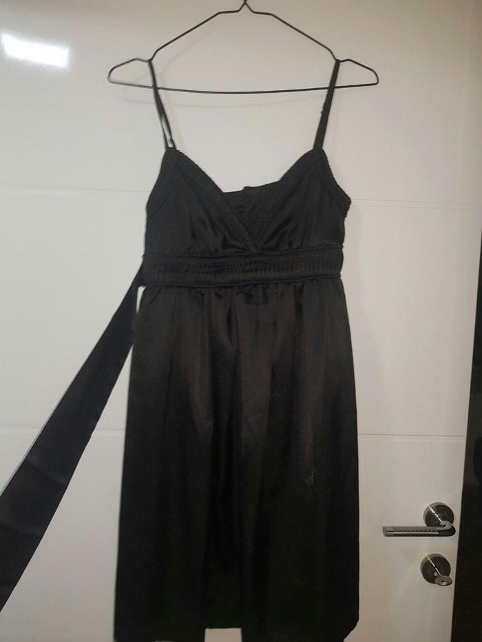 Crna haljina. Photo 0